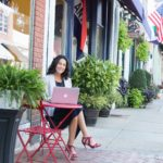 Rachel Frentsos writing a blog article in downtown Annapolis